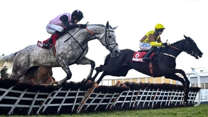 Galopin Des Champs (R) with Paul Townend up, jumps the sixth on their way to winning the Irish Mirror Novice Hurdle