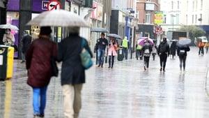 People on Dublin's Grafon Street shopping for hot water bottles, warmer duvets and bigger umbrellas