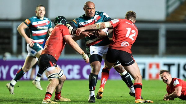 Nemani Nadolo is tackled by Nick Timoney and Stuart McCloskey