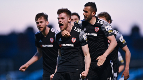 Cameron McJannet of Derry City, left, celebrates with team-mates