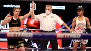 Katie Taylor has her arm raised in victory