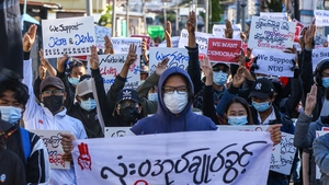 Protesters make the three-finger salute during a demonstration against the military coup on Global Myanmar Spring Revolution Day in Taunggyi, Shan state