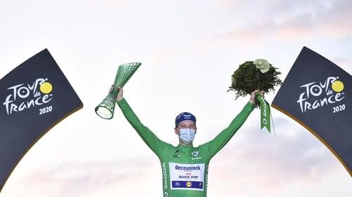 Ireland's Sam Bennett celebrates on the podium after winning the best sprinter's green jersey at the 2020 Tour
