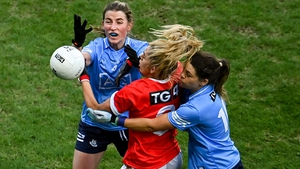 Máire O'Callaghan of Cork in action against Aoife Kane and Noelle Healy during last December's All-Ireland final