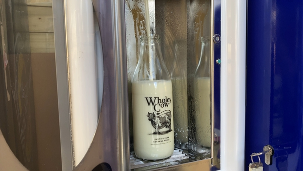 One litre bottle of milk being filled at the Wholey Cow 'Milk Shack'