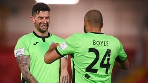 Adam Foley, left, and Ethan Boyle celebrate after beating Derry City