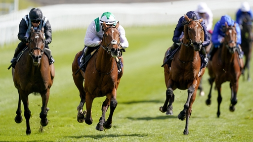 Youth Spirit (white and green silks) bounds clear of his rivals on the Roodee
