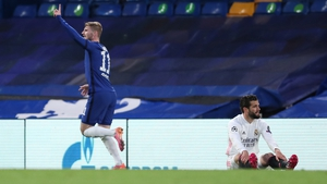 Timo Werner celebrates his goal as Real Madrid defender Nacho looks on