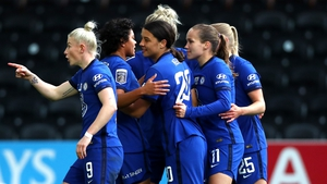 Chelsea's Sam Kerr is mobbed after her second goal