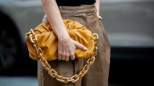 Justyna Czerniak carrying a Bottega Veneta bag during Copenhagen fashion week SS21.