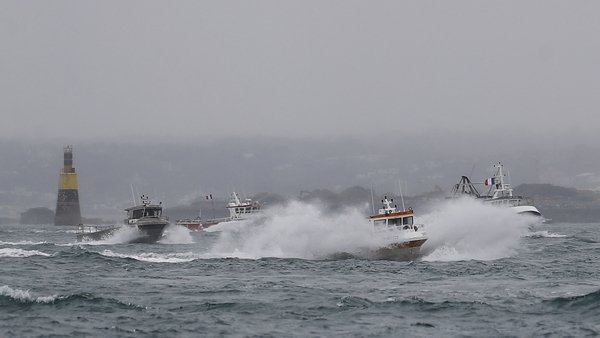 French fishing boats leave the Jersey waters following their protest in front of the port of Saint Helier