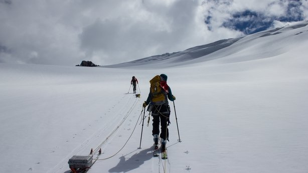 Scientists carrying out measurements on Conrad Glacier, Canada