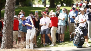 Rory McIlroy plays a tricky shot on the 10th on his first round