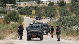 Members of the Israeli security bar the road near the Salem checkpoint leading to the West Bank town of Jenin