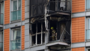 London Fire Brigade said The service said around 100 firefighters were working to put the fire out