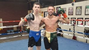 Stevie McKenna (left) with reigning world champion Josh Taylor