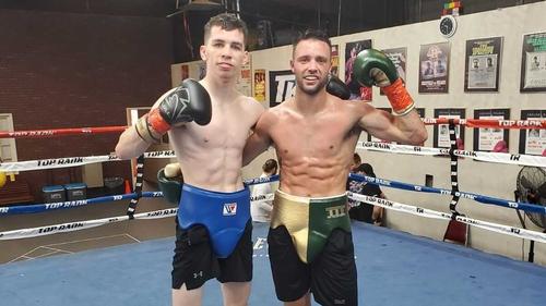 Stevie McKenna (left) with reigning world champion Josh Taylor