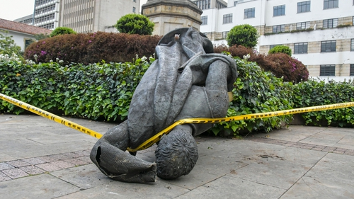 The statue of Spanish conquistador Gonzalo Jimenez de Quesada after being knocked down in Bogota today