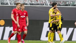 Mats Hummels and Raphael Guerreiro of Borussia Dortmund celebrate the win