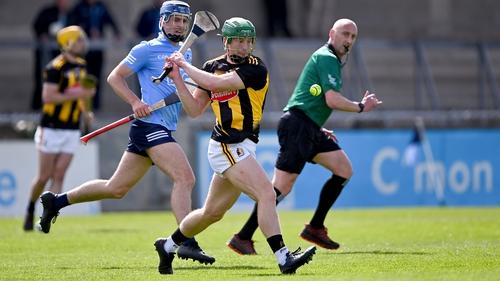 Martin Keoghan gets a shot away with Dublin's Seán Moran looking on