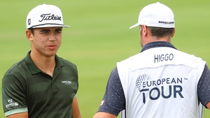 Garrick Higgo and his caddie on the 18th hole as he held a two-shot lead
