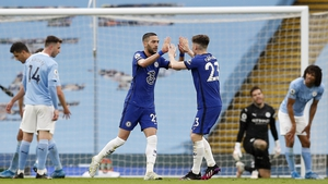 Hakim Ziyech celebrates with Billy Gilmour (R) after scoring the Chelsea equaliser