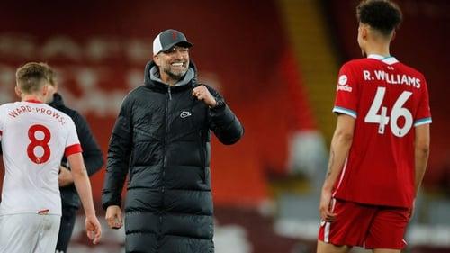 Jurgen Klopp celebrates a rare home win in the league