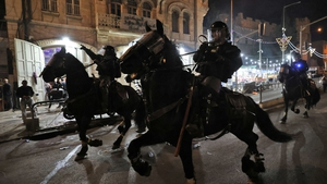 Israeli mounted police deploy to disperse Palestinian protesters outside the Damascus Gate in Jerusalem's Old City