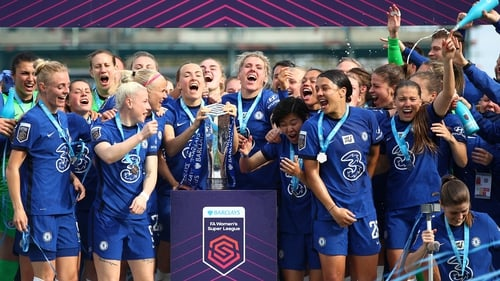 Millie Bright and Magdalena Eriksson of Chelsea lift the Barclays FA Women's Super League Trophy
