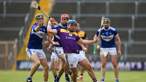 Wexford's Kevin Foley takes the hurley of Laois' Sean Downey
