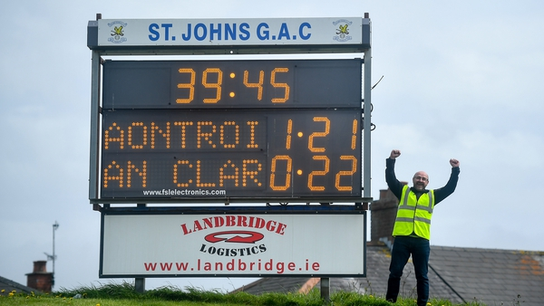 Corrigan Park steward Conor McCaffrey celebrates Antrim's win over Clare