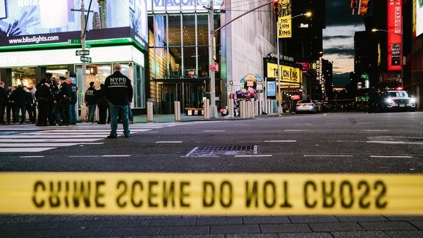 Crime scene tape at a closed-off street on Times Square after the gun incident