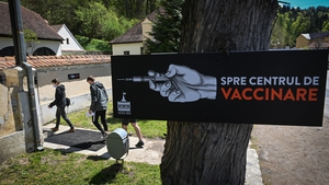 A poster points the way to the free vaccination centre at Bran Castle