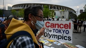 A protest against the hosting of the Games took place outside the Olympic museum in Tokyo on Sunday