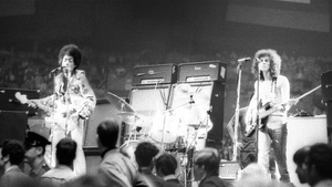 Noel (right) on stage with Jimi Hendrix and drummer Mitch Mitchell