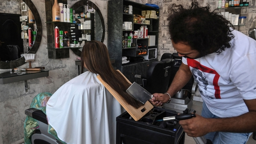 Pakistani barber Ali Abbas cutting hair with a cleaver