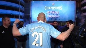 Fans outside the Etihad Stadium celebrate a fifth league title in a decade
