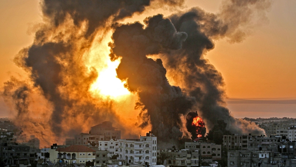 A fire rages in Khan Yunish following an Israeli airstrike on targets in the southern Gaza strip