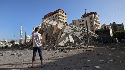 Israeli troops gather at Gaza border amid air strikes, rocket fire