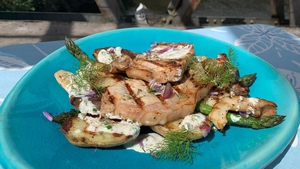 BBQ pork rack chops with grilled potatoes and asparagus, yoghurt dressing.