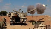 Israeli soldiers fire a 155mm self-propelled howitzer towards Gaza from their position near the southern Israeli city of Sderot