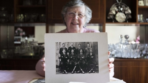 Mary Barrett with a photo of Terence MacSwiney's bodyguards (pic: Clare Keogh)