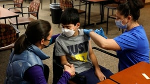 A teenager receives the Covid-19 vaccine in Bloomfield Hills, Michigan in the US today