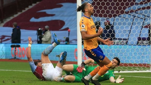 Tyrone Mings collides with Aston Villa team-mate Emiliano Martinez