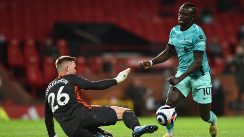 Sadio Mane in action against Manchester United goalkeeper Dean Henderson at Old Trafford