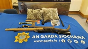 Two imitation firearms were seized in the searches