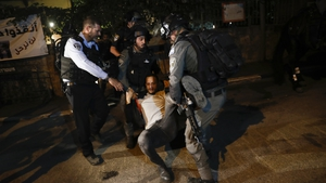 Israeli police with a Palestinian protester in east Jerusalem