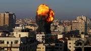Smoke and flames rise after airstrikes over Ansar Government Complex building in Gaza city