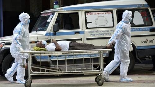 A coronavirus patient arrives at a hospital in Kilkata, India