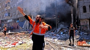 A Palestinian firefighter gestures to colleagues following an Israeli strike on Rafah town in the southern Gaza Strip